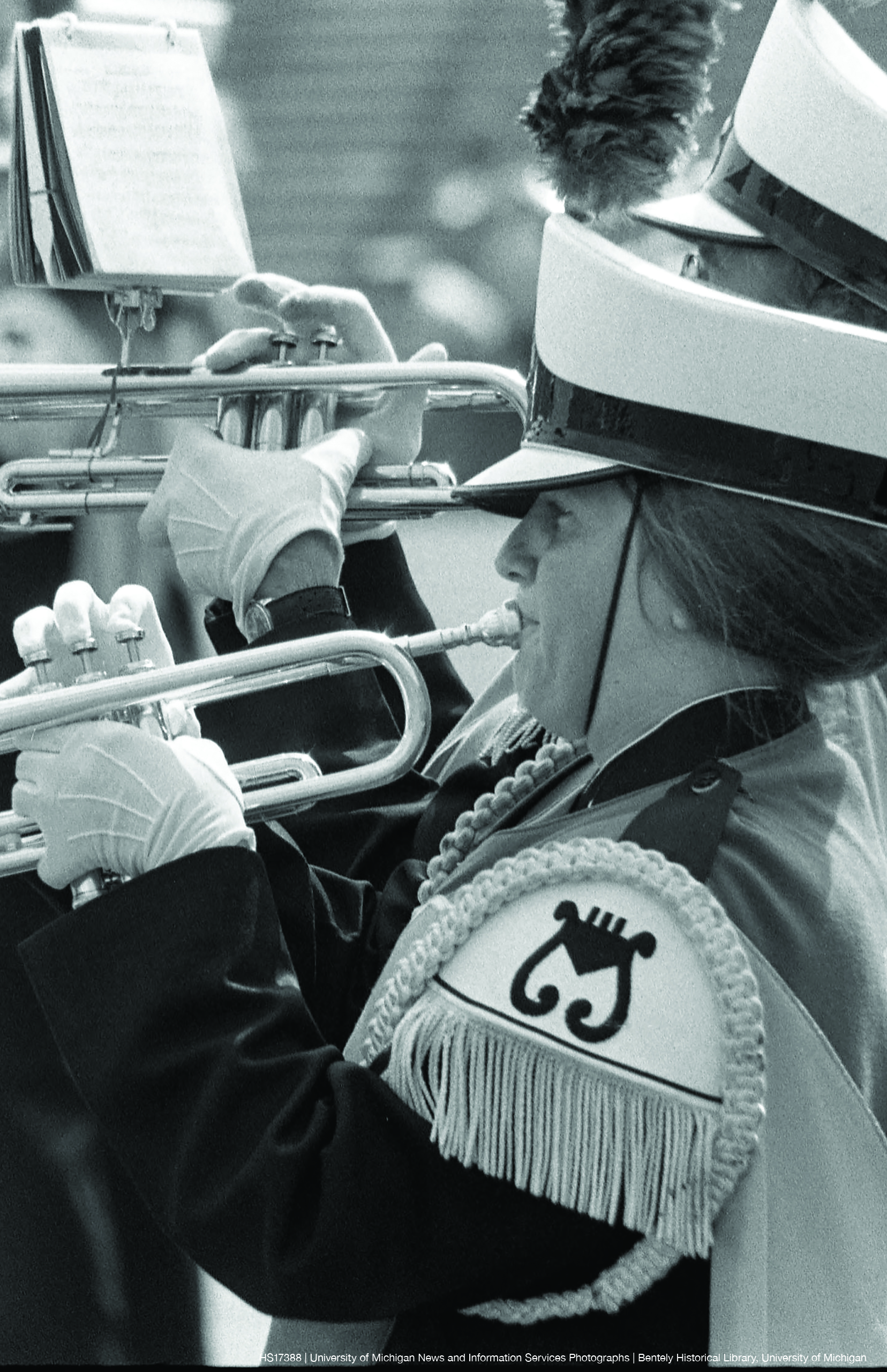 Photo of a woman playing trumpet in the Michigan Marching Band